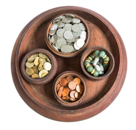 Isolation money and coins in container wood art in thailand photo