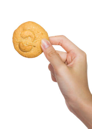 Isolation Hand holding cookie on white studio background  Stock Photo