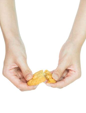 Isolation Hand holding cookie on white studio background  photo