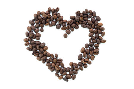 coffee beans make a heart on a white background