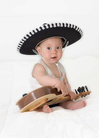 The little boy in a sombrero with a guitar on a white background
