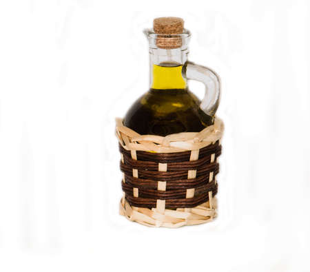 liquidate: Olive oil in a small jug on a white background