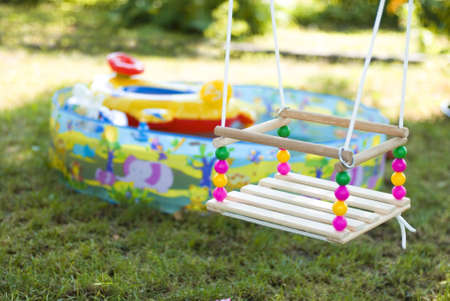 unoccupied: Childrens swing and toys on a childrens playground in a garden