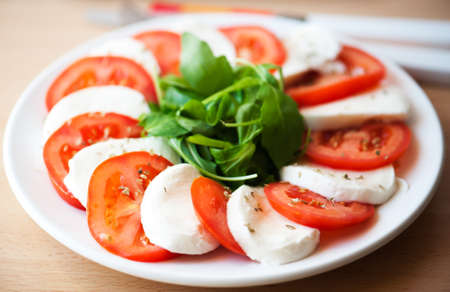 Italian salad with tomatoes and mozzarella photo