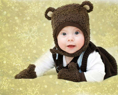 baby in suit: A boy dressed as Bear in the yellow background of the New Year Stock Photo