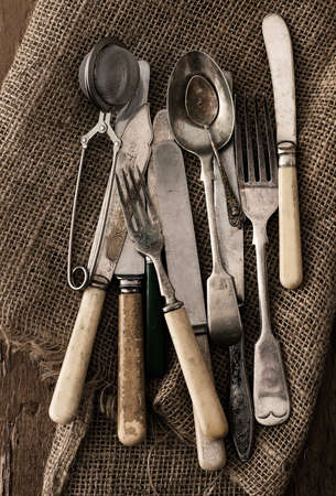 Old cutlery against sacking photo