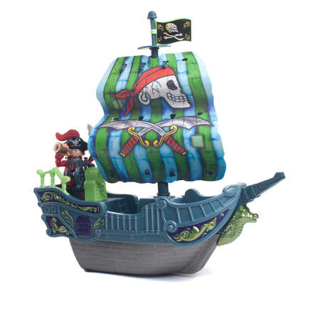 Pirate ship with a pirate on a white background Foto de archivo