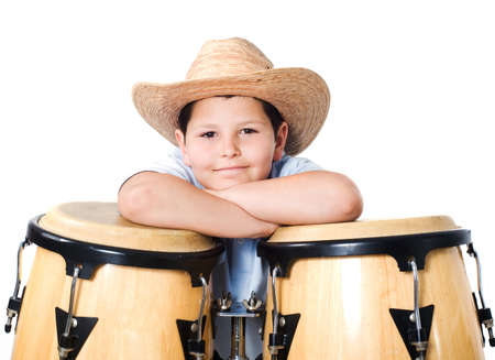 A boy wearing a hat with the drums on a white background Foto de archivo