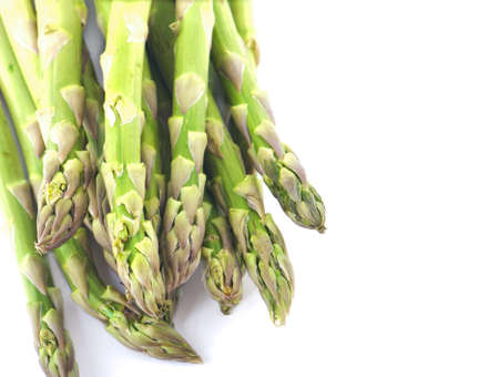 Green asparagus on a white isolated background photo