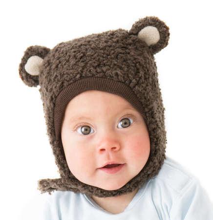 little boy in a cap with ear flaps