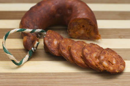 precedent: Smoked sausage on a wooden board Stock Photo