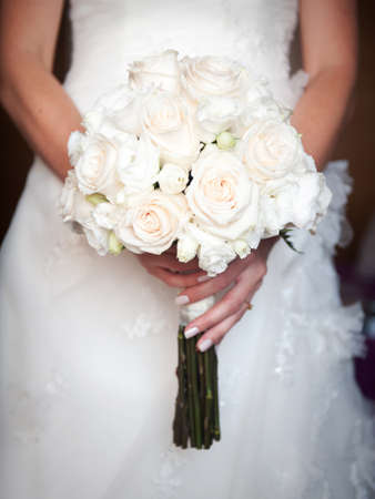 occasions: Beautiful wedding bouquet in hands of the bride