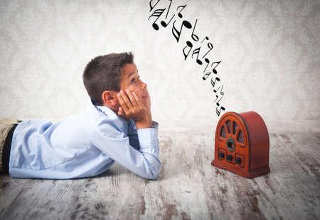 handsome young boy listening to retro radio