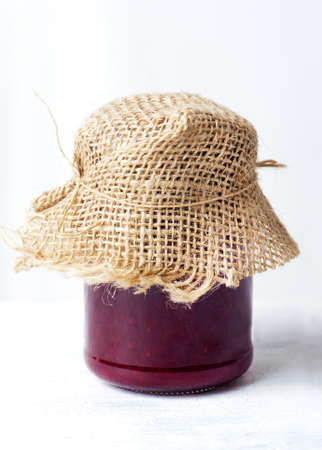 Raspberry jam on a white background isolated photo