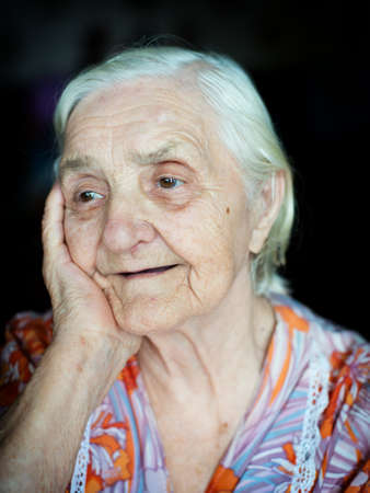 Portrait of a cheerful grandmother eighty-seven years photo