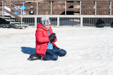 to steer a sledge: Young handsome boy having fun playing with snow
