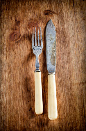 vintage cutlery: old vintage cutlery on a wooden table