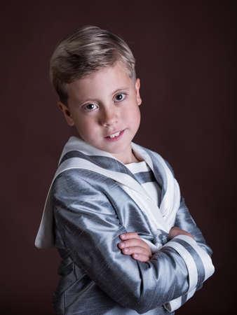 Beautiful cute sailor boy photo