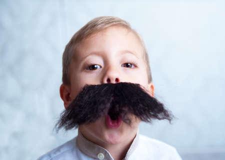 A little boy with a mustache photo