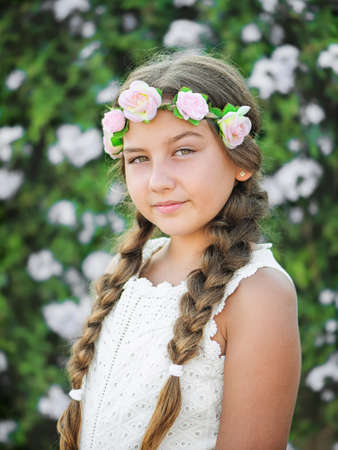Beautiful little girl with braids on nature background Stock Photo
