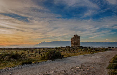 Landscape at sunset with an old tower