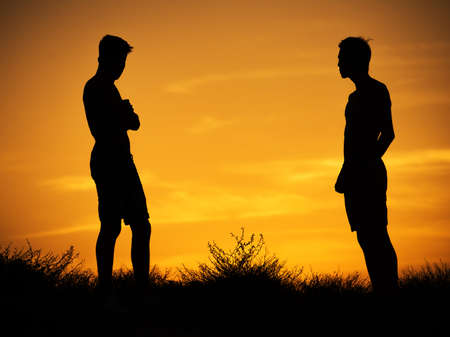 silhouettes of two young friends of the guys.