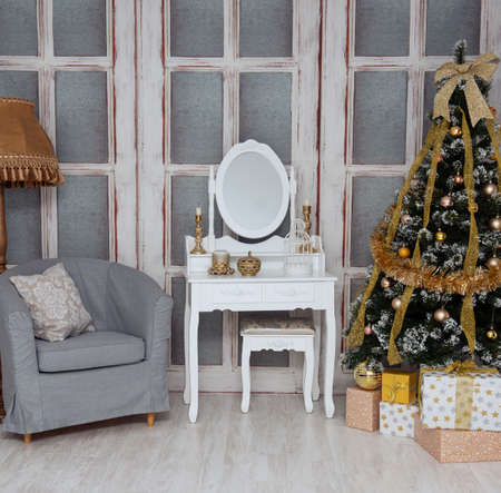 Room with a beautiful Christmas tree with gold toys
