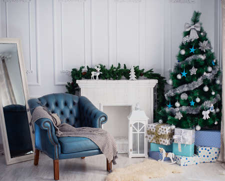 Room with a Christmas tree and fireplace 스톡 콘텐츠