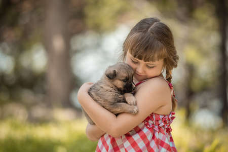 Cute little girl with a little puppy.