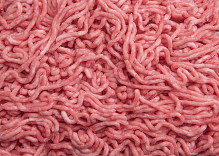 Beef minced meat as background, top view