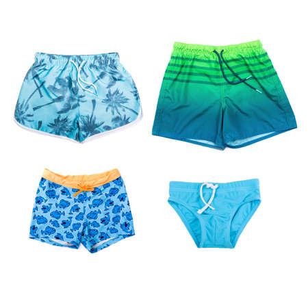 Collage of different shorts for boys on white background. Stock Photo