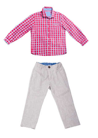 Childrens clothing shirt and pants on white background.