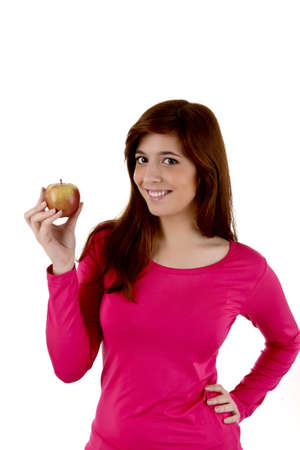 Young woman with apple in hand photo