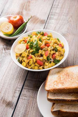 Masala Anda Bhurji of egg bhurji or Spicy scrambled eggs with bread slices or pav or paav and salad, tasty anda bhurji paav