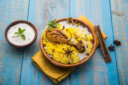Chicken biryani made in authentic basmati rice and big leg piece Banco de Imagens