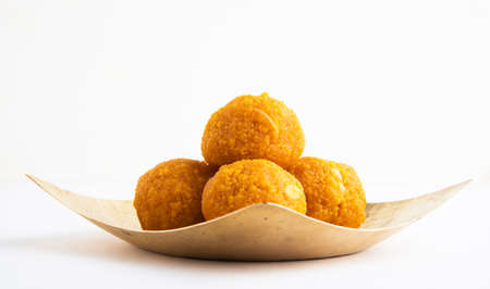 Laddu or laddoo, the sphere-shaped sweets originated from the Indian subcontinent on white background Stock Photo