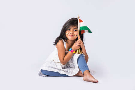 indian flag and cute little indian girl, 4 year indian girl with indian flag or tricolour, india flag & girl, girl holding indian flag, indian independence day, indian republic day, isolated on white
