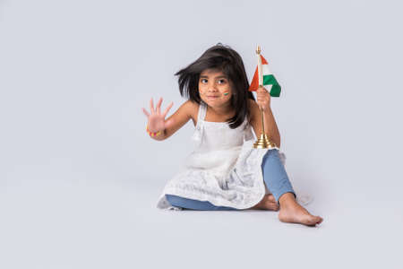 tricolour: indian flag and cute little indian girl, 4 year indian girl with indian flag or tricolour, india flag & girl, girl holding indian flag, indian independence day, indian republic day, isolated on white