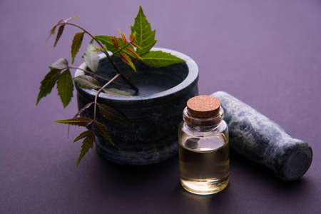 inhalation: Ayurvedic Herbs Neem with Oil in bottle with mortar