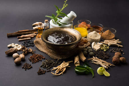 Close up of an Indian Ayurvedic dietary supplement called Chyawanprash  chyavanaprasha on dark grey background