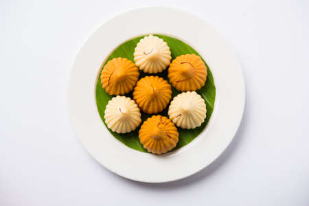 A modak is an Indian sweet dumpling popular in India. It is called modak, Kozhakkatta, modhaka, kadubu, modhakam, kozhakkattai, kudumu. made up of coconut and jaggery, rice flour, wheat with khava Banco de Imagens