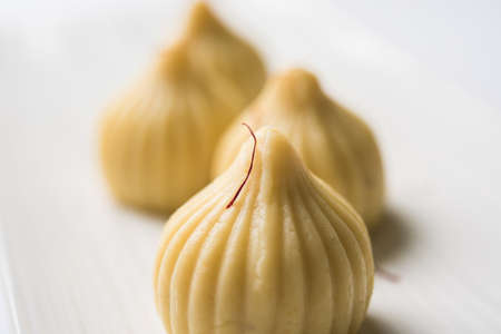A modak is an Indian sweet dumpling popular in India. It is called modak, Kozhakkatta, modhaka, kadubu, modhakam, kozhakkattai, kudumu. made up of coconut and jaggery, rice flour, wheat with khava Archivio Fotografico