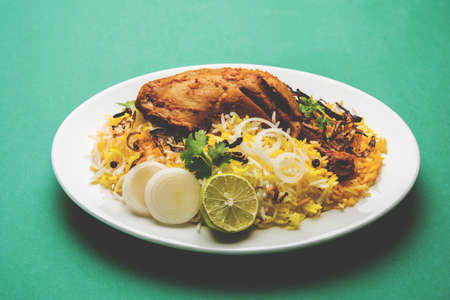 Hyderabadi Biryani is most well-known Non-Vegetarian culinary delights from the famous Hyderabad Cuisine. A traditional Indian dish made using Basmati rice, chicken meat & various other exotic spices. Stock Photo - 82195056