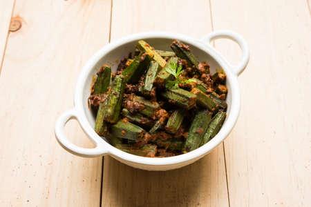 spice: Indian masala fried bhindi or bhendi or Okra or ladyfinger curry or sabji, selective focus