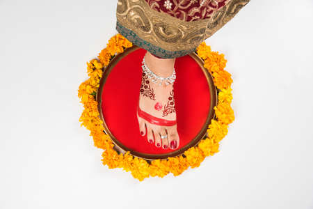 Gruha Pravesh Gruhapravesh Griha Pravesh closeup picture of right feet of a Newly married Indian & Door Stepping Stock Photos. Royalty Free Door Stepping Images