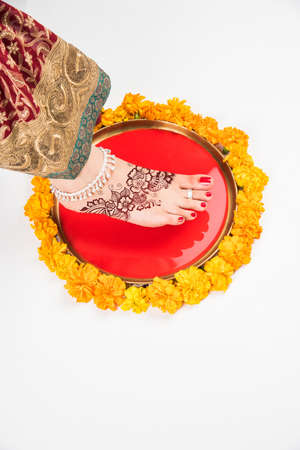 the grand daughter: Gruha Pravesh  Gruhapravesh  Griha Pravesh, closeup picture of right feet of a Newly married Indian Hindu bride dipping her fit in a plate filled with liquid kumkum then stepping in husbands house
