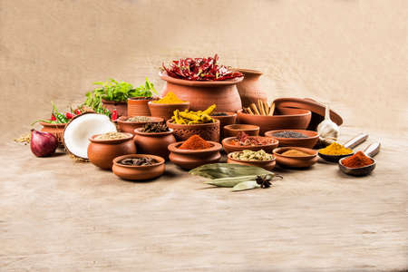 indian spices in terracotta pots, indian colourful spices, group of indian spices, group of spices, india and spices arranged in different size terracotta pots