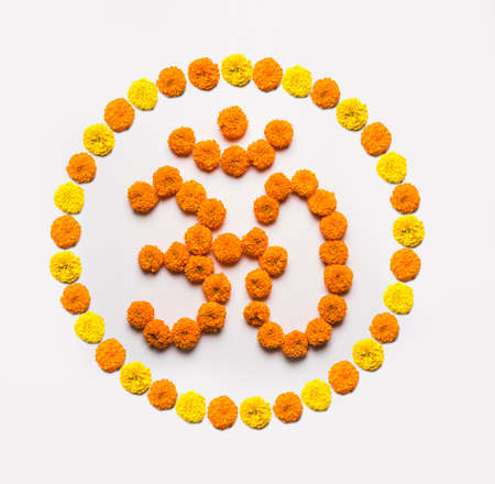 pendent: Stock photo of word Aum or om made using marigold flower arrangement