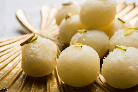 Stock Photo of Rasgulla or sponge Ras Gulla, It is made from ball shaped dumplings of chhena and semolina dough, cooked in light syrup made of sugar. Stock Photo