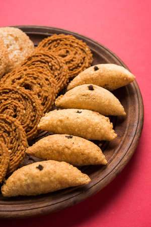 murkoo: stock photo of Indian festival or diwali food called chakli, anarsa and karanji or Gujiya, selective focus
